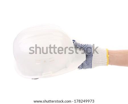 Hand holding white hard hat. Isolated on a white background. - stock photo