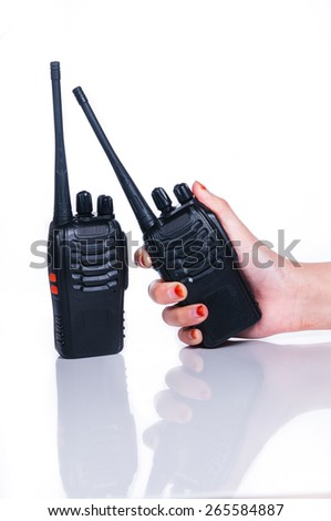 Hand holding Wireless Radio Communication on white with reflection - stock photo
