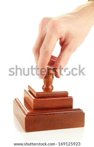 Hand holding wooden stamp isolated on white - stock photo