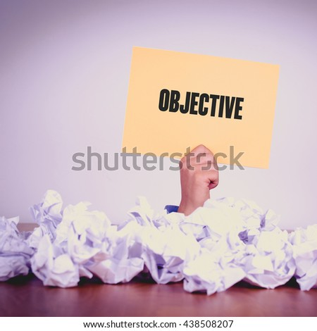 HAND HOLDING YELLOW PAPER WITH OBJECTIVECONCEPT - stock photo