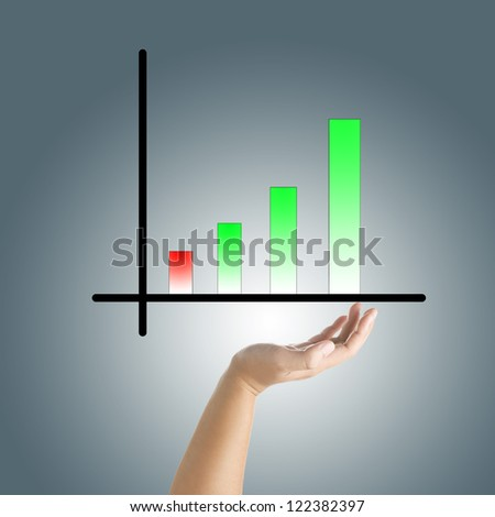 Hand holds a growth green graph - stock photo