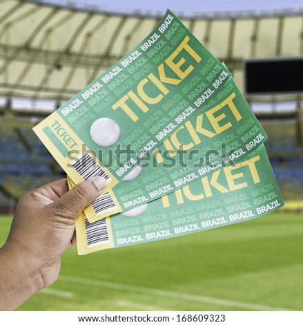 Hand holds a homemade soccer tickets in the stadium - Brazil - stock photo
