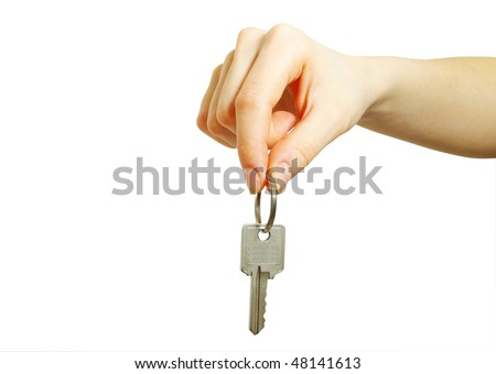 hand holds a key - stock photo