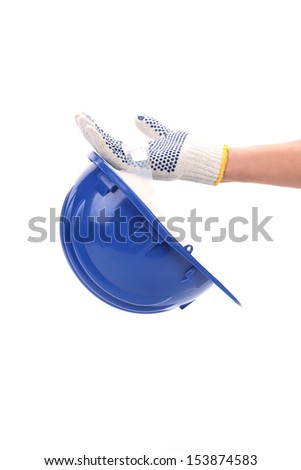 Hand holds blue hard hat. - stock photo