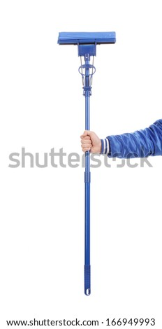 Hand holds blue mop with sponge. Isolated on a white background. - stock photo