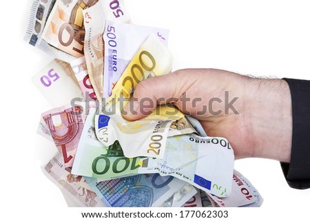 Hand holds bunch of crumpled cash - stock photo