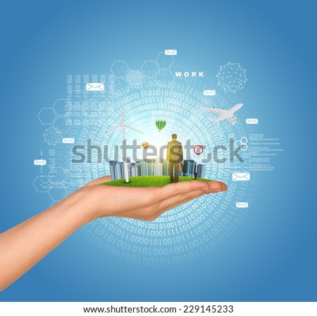 Hand holds city of skyscrapers on green grass and businessman walking forward. Circles of figures as backdrop. Business concept - stock photo
