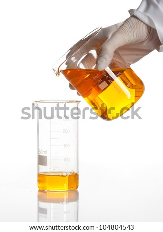 Hand holds flask to make a chemical reaction, isolated - stock photo