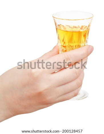 hand holds glass of dessert wine isolated on white background - stock photo