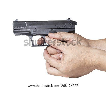hand holds gun isolated on white background. - stock photo