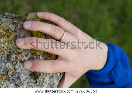hand holds on stone - stock photo