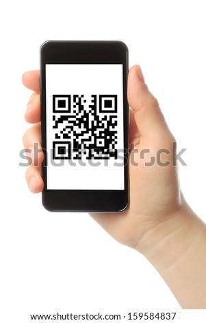 Hand holds smart phone with QR code on white background  - stock photo