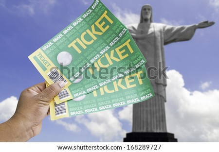 Hand holds soccer tickets in Rio de Janeiro, Brazil - stock photo
