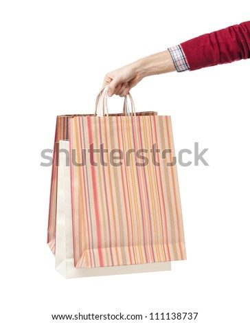 Hand holds some paper bags, isolated on white - stock photo
