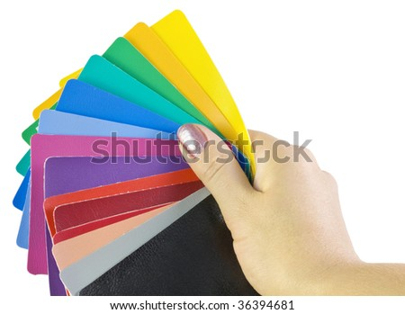 hand holds the colored skin samples - stock photo