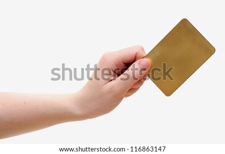 hand holds the golden card - stock photo
