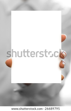 hand holds white blank business card in focus - stock photo