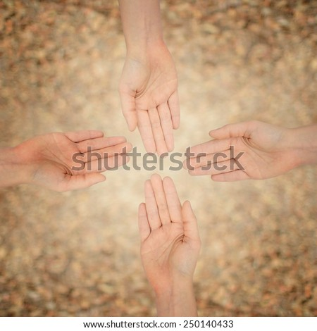 hand human below hand - stock photo