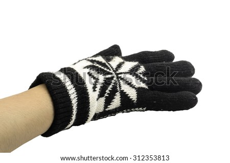 hand in a black and white woollen glove on a white background - stock photo