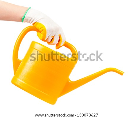 Hand in a glove with watering can isolated on white background - stock photo