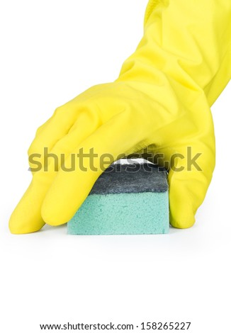 Hand in a rubber glove cleaning a white surface with a sponge. - stock photo