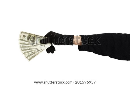 Hand in black glove holding money isolated on white background - stock photo