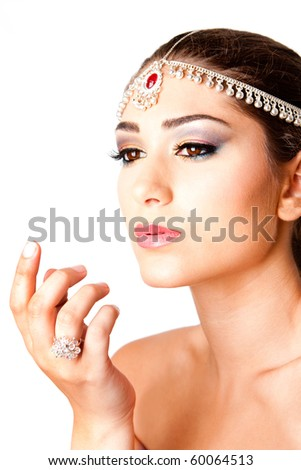 Hand in front of a beautiful Middle Eastern Egyptian Israeli Lebanese Turkish Arabic woman Face with makeup in the Belly Dancer style, isolated. - stock photo