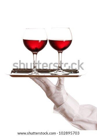 Hand in glove holding silver tray with wineglasses isolated on white - stock photo