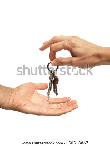 hand in hand over the keys - stock photo