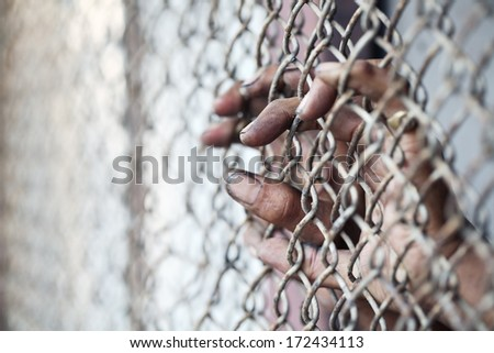 hand in jail. - stock photo