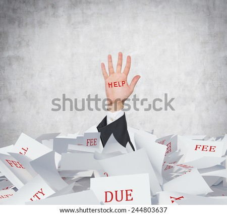 hand in papers heap with drawing help - stock photo