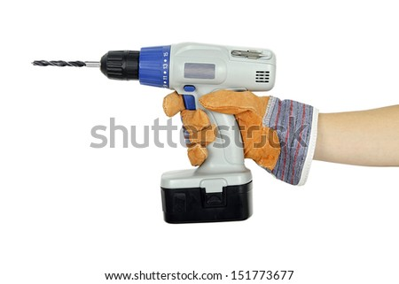 hand in protective glove with cordless drill - stock photo