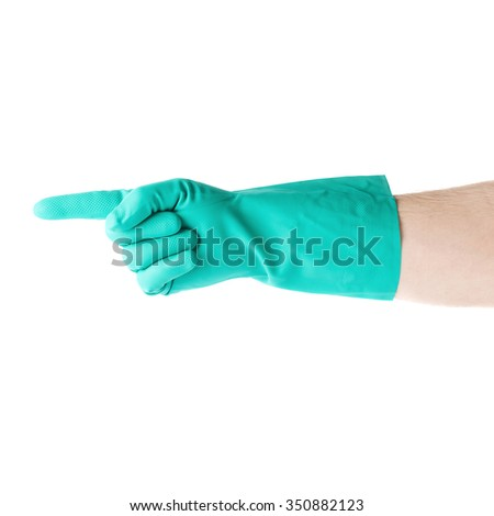 Hand in rubber latex green glove  with counting one pointing finger sign gesture over white isolated background - stock photo