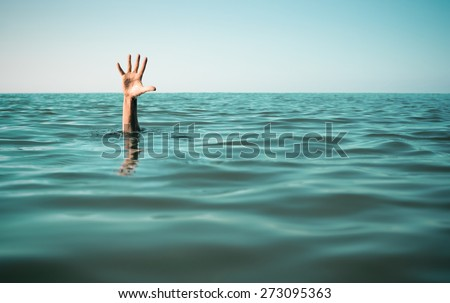 Hand in sea water asking for help. Failure and rescue concept. - stock photo