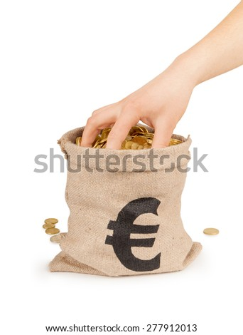 hand in the bag with coins isolated on white - stock photo