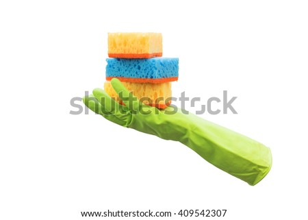 hand in the glove holds a sponge - stock photo