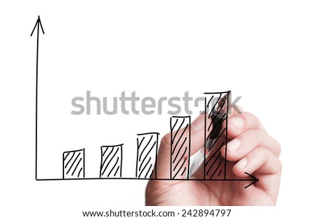 Hand is drawing a chart on transparent white board. - stock photo