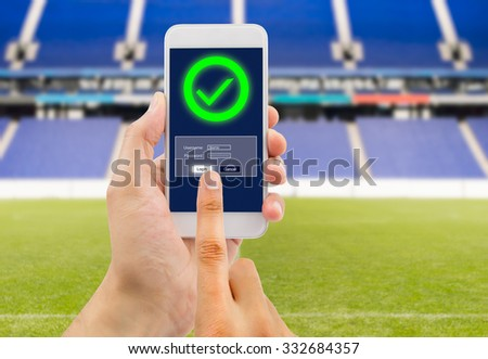 hand is entering password to betting online at the web - stock photo