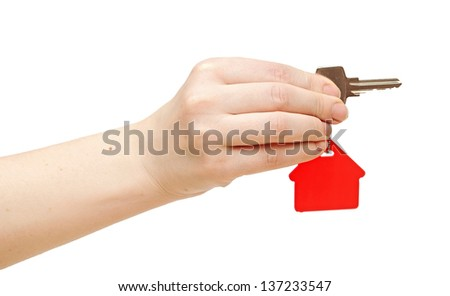 hand is handing a house key - stock photo