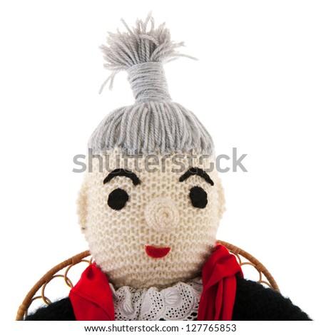 hand knitted grandma sitting on chair - stock photo