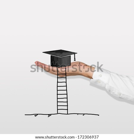 Hand, ladder and a graduation hat - stock photo
