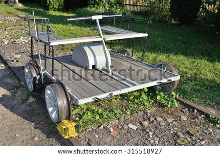Hand-lever draisine handcar - light auxiliary rail vehicle, driven by service personnel, equipped to transport crew and material necessary for the maintenance of railway infrastructure. - stock photo