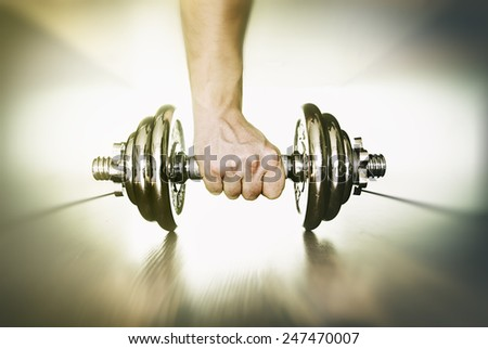 Hand Lifting Dumbbell - stock photo