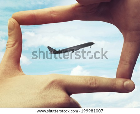 hand made frame and look at the plane - stock photo