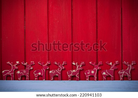 Hand made natural Christmas reindeer on wooden background with copy space - stock photo