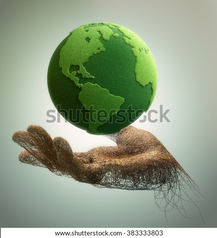 hand made of branches holding a green earth - stock photo