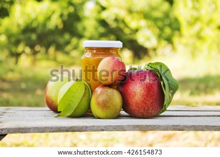 hand made peach marmalade and peach's core - stock photo