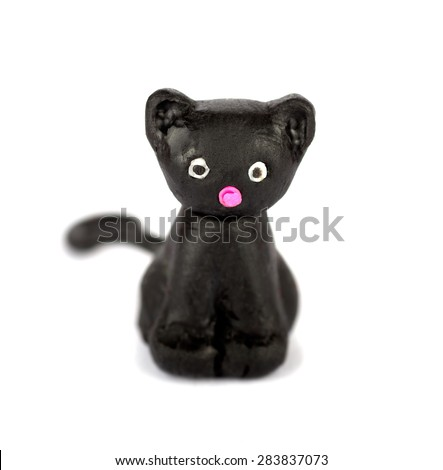 Hand made plasticine or modeling clay figure of a cat on white background.Shallow DOF - stock photo