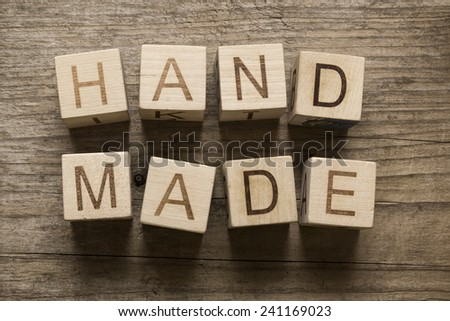 hand made text on a wooden blocks on a wooden background - stock photo