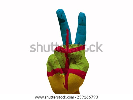 Hand making the V sign country flag painted berber people - stock photo